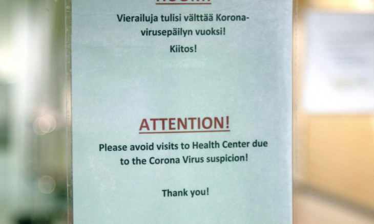 Advisory sign hangs on door of health centre in Ivalo