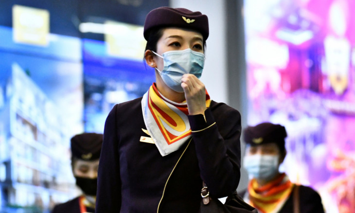 Flight crew wearing masks arrives on direct flight from China at Vancouver International Airport