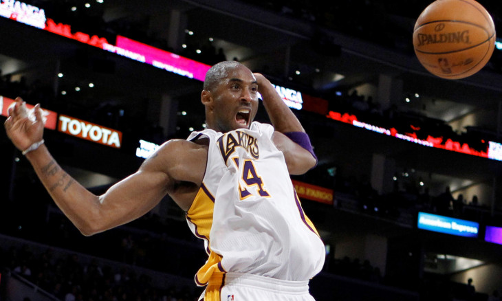 FILE PHOTO: Los Angeles Lakers Bryant celebrates after dunking against the New York Knicks during their NBA basketball game in Los Angeles