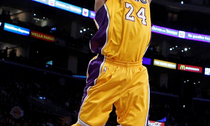 FILE PHOTO: Lakers' Bryant slam dunks against the Kings during their NBA basketball game in Los Angeles