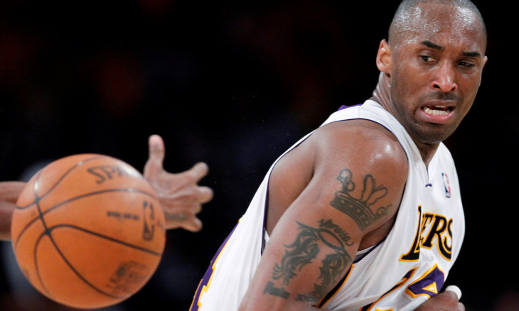 FILE PHOTO: Lakers' Bryant loses control of the ball during Game 1 of their NBA Western Conference game against the Hornets in Los Angeles