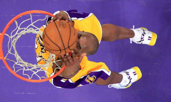 FILE PHOTO: Los Angeles Lakers Bryant slam dunks against the Toronto Raptors during NBA game in Los Angeles