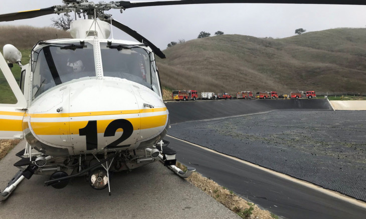 LA county firefighters are seen before taking off to a scene of a helicopter crash that reportedly killed Kobe Bryant in Calabasas