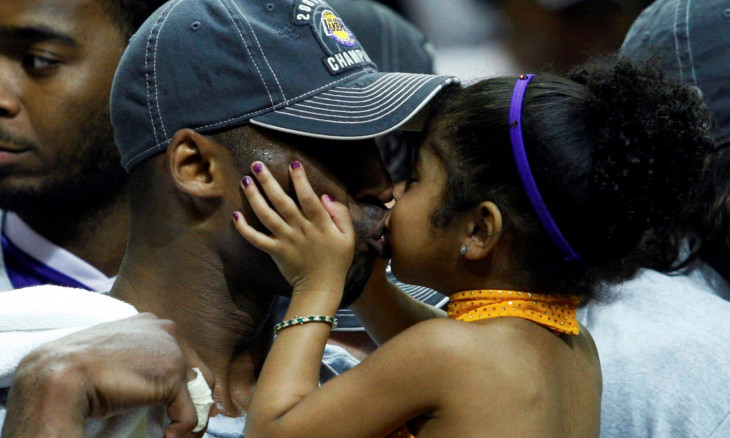 FILE PHOTO: Los Angeles Lakers Kobe Bryant kisses his daughter Gianna after they defeated the Orlando Magic to win the NBA basketball championship in Orlando