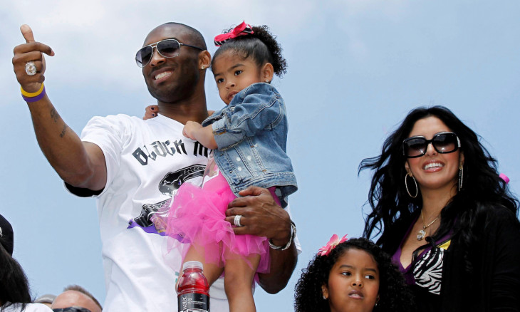 FILE PHOTO: Bryant carries his daughter Gianna, as Vanessa and daughter Natalia stand next to him during the NBA Championship parade in Los Angeles