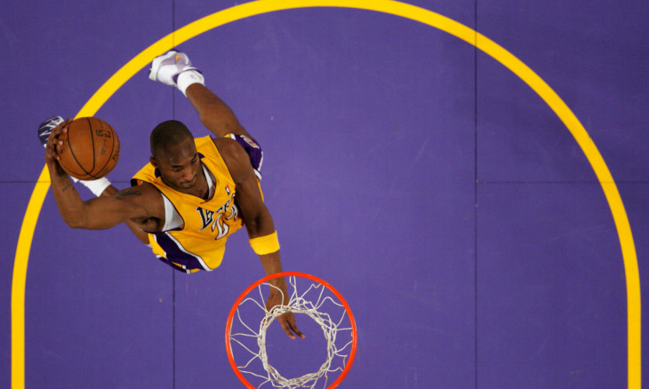 FILE PHOTO: Lakers Kobe Bryant goes up for a dunk against the New York Knicks during their NBA basketball game in Los Angeles