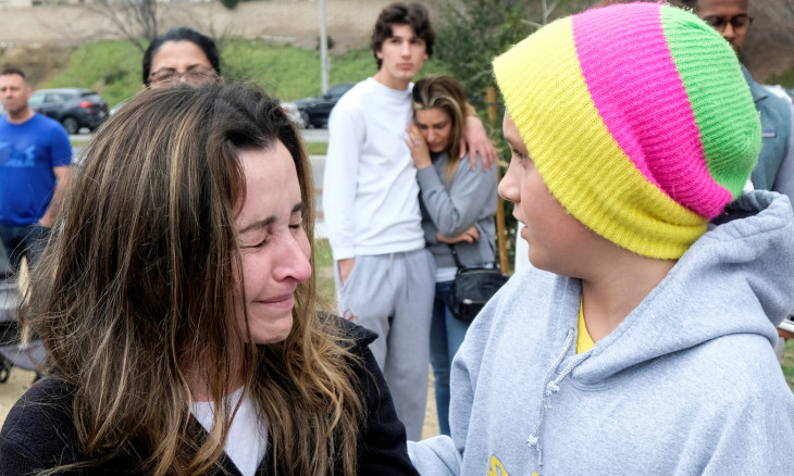 Kate Grinblat and her son Bobby react near the scene of a helicopter crash that reportedly killed retired basketball star Kobe Bryant in Calabasas