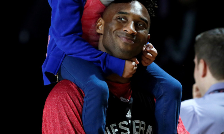 FILE PHOTO: Los Angeles Lakers Kobe Bryant holds his daughter Natalia during practice for the NBA All-Star basketball game in Houston