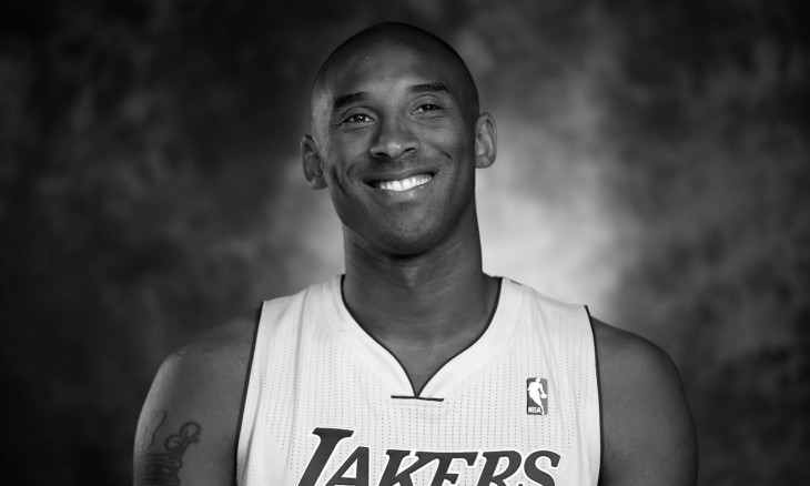 FILE PHOTO: Lakers guard Kobe Bryant smiles during an interview at NBA media day for the Los Angeles Lakers basketball team in Los Angeles