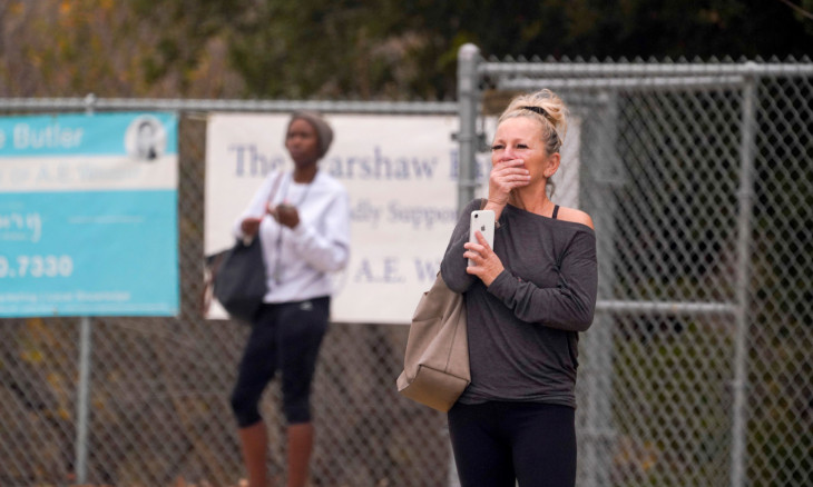 Spectators react near the scene of a helicopter crash that reportedly killed retired basketball star Kobe Bryant in Calabasas