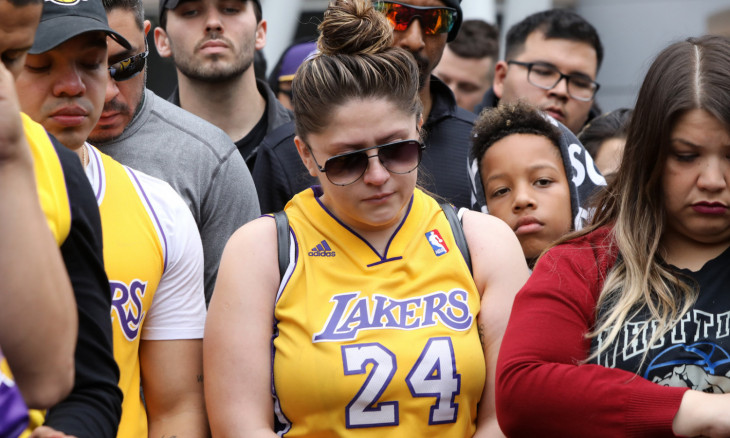 People mourning the death of former Los Angeles Lakers basketball star Kobe Bryant arrive at a makeshift shrine in Los Angeles, California, U.S. January 26, 2020