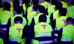 Employees of Tesla are seen during a delivery event for Tesla China-made Model 3 cars in Shanghai