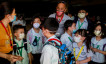 Guardians and students wear masks amid a health scare over a new virus that has infected thousands since emerging in China, in a Chinese school in Quezon City, Metro Manila, Philippines