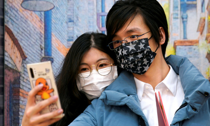 Wang, 32, and his wife Shi, 30, wearing masks are seen at a marriage registry office on Valentine's Day in Shanghai