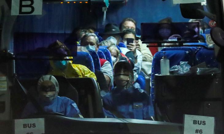 A bus believed to carry the U.S. passengers of the cruise ship Diamond Princess, where dozens of passengers were tested positive for coronavirus, leaves the Daikoku Pier Cruise Terminal in Yokohama