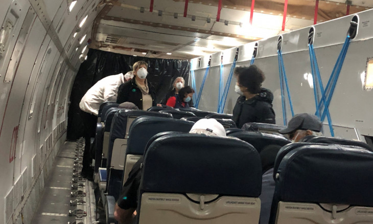 U.S. passengers on board the Diamond Princess cruise ship, who have chosen to leave, are seen in a chartered evacuation aircraft to fly back to the United States, at Haneda airport in Japan