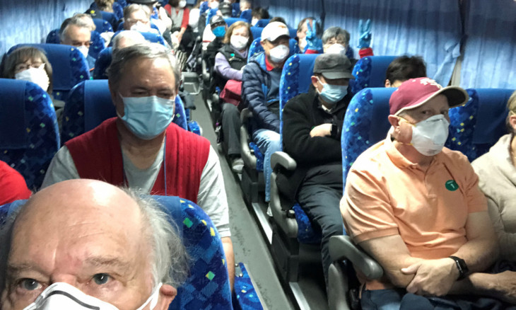 U.S. passengers on board the Diamond Princess cruise ship, who have chosen to leave, are transported by shuttle bus in Yokohama to Haneda airport to fly back to the United States via chartered evacuation aircraft, in Japan