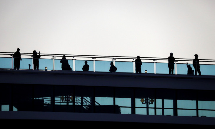 FILE PHOTO: Passengers are seen on the cruise ship Diamond Princess, as the vessel's passengers continue to be tested for coronavirus, at Daikoku Pier Cruise Terminal in Yokohama, south of Tokyo