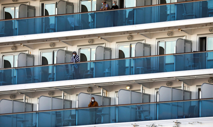 Passengers are seen on the cruise ship Diamond Princess, as the vessel's passengers continue to be tested for coronavirus, at Daikoku Pier Cruise Terminal in Yokohama, south of Tokyo