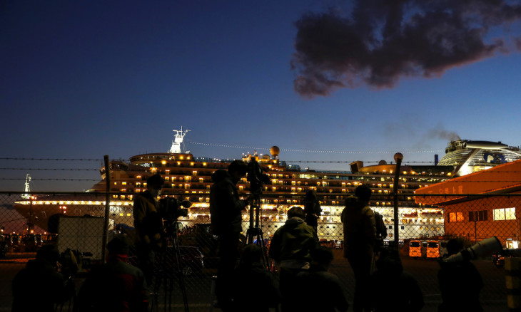 The cruise ship Diamond Princess is seen, as the vessel's passengers continue to be tested for coronavirus, at Daikoku Pier Cruise Terminal in Yokohama, south of Tokyo