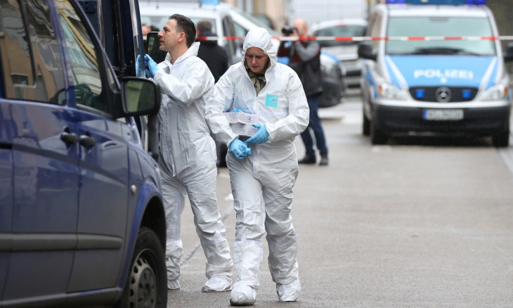 Forensic investigators are seen outside the Midnight Shisha bar following a shooting in Hanau