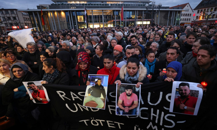 People attend a vigil for the victims of a shooting in Hanau