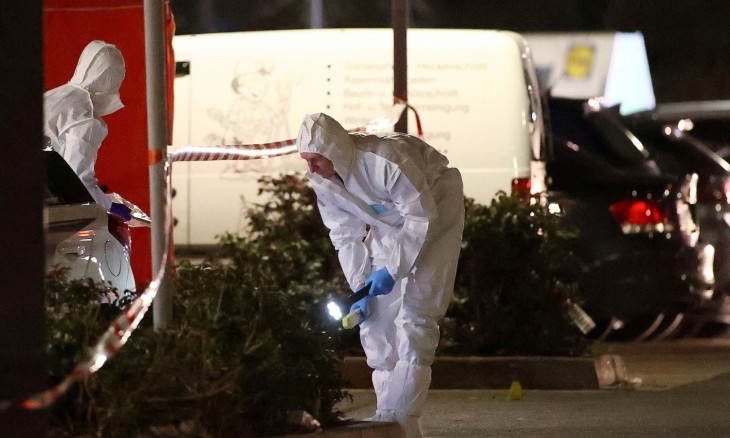 Forensic experts search the area after a shooting in Hanau near Frankfurt