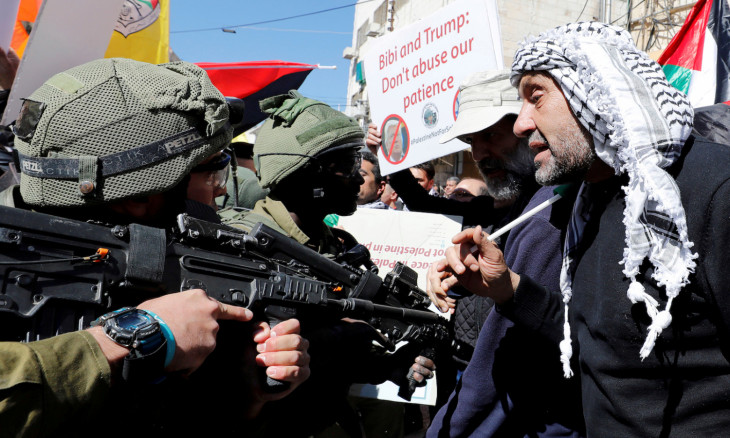 Palestinian demonstrators argue with Israeli forces during a protest marking the 26th anniversary of shooting attack by Jewish settler Goldstein, in Hebron in the Israeli-occupied West Bank