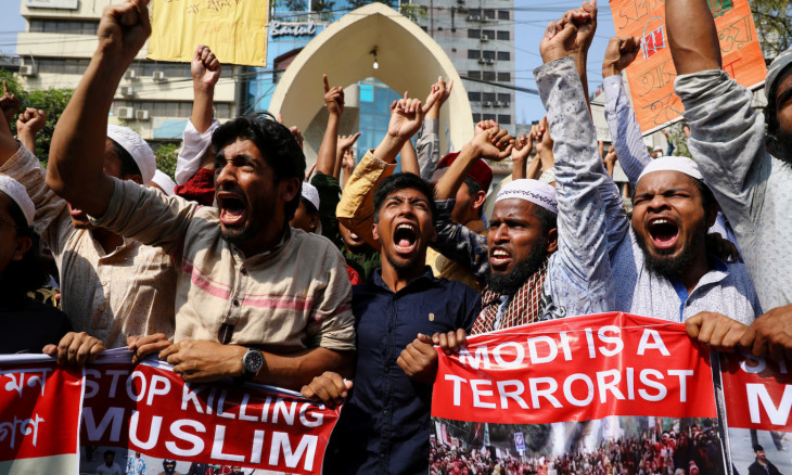 Muslims shout slogans as they protest the violence against Muslims in India and Indian Prime Minister Narendra Modi's scheduled visit to Bangladesh in Dhaka