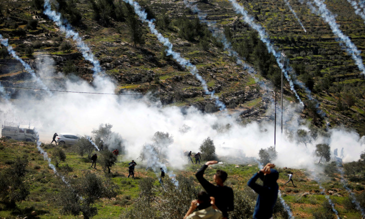 Tear gas canisters are fired by Israeli forces towards Palestinian demonstrators during a protest against Israeli settlements and Trump's Middle East peace plan, in Beita town in the Israeli-occupied West Bank