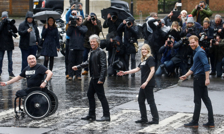 Britain's Prince Harry meets Jon Bon Jovi and members of the Invictus Games Choir in London