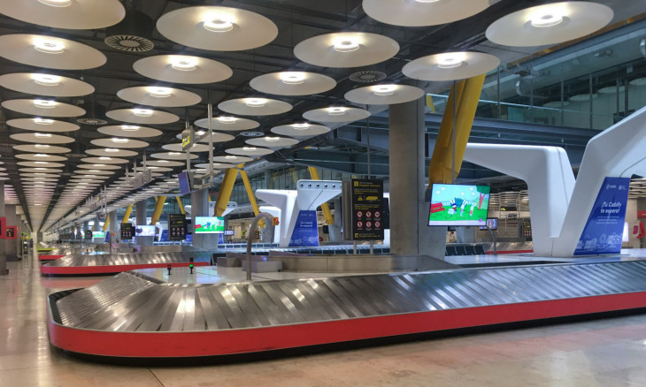 Empty baggage carousels are seen at Madrid's Adolfo Suarez Barajas Airport