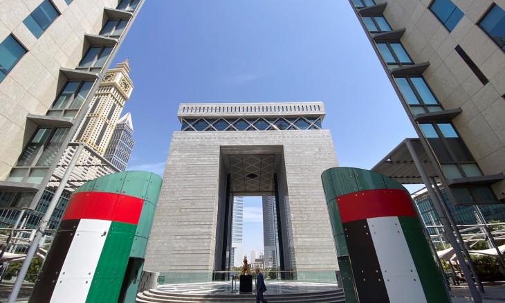 A man walks at the Dubai International Financial Centre in Dubai