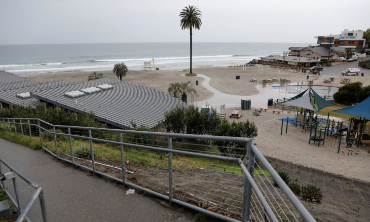 A playground and empty beach are shown void of people due to the global outbreak of the coronavirus disease (COVID-19) in Encinitas, California