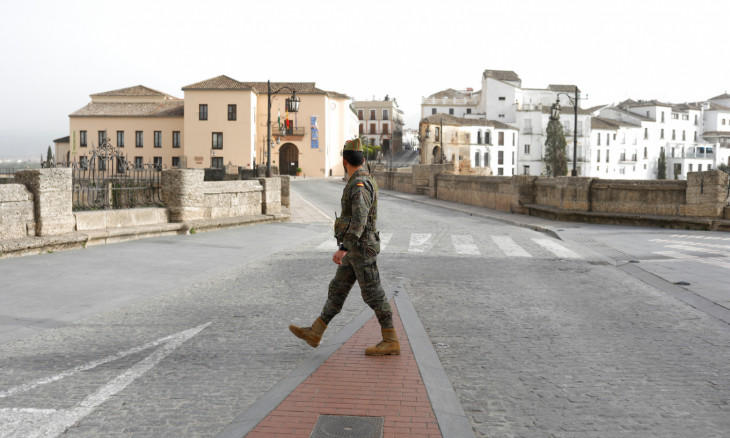 A Spanish legionnaire patrols in an empty Puente Nuevo in downtown Ronda