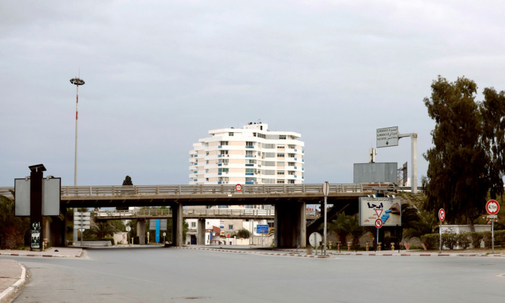 General view shows empty streets at the entrance of Ariana city during a curfew to counter the spread of the coronavirus, near Tunis