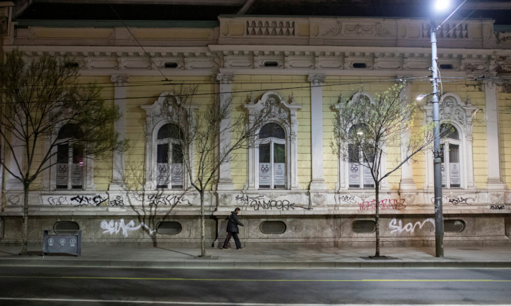 A man walks alongs an empty street during a curfew imposed to prevent the spread of coronavirus disease (COVID-19) in Belgrade