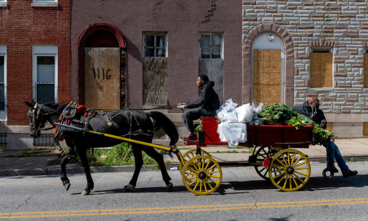 Food to be given away is transported by horse to the residents of West Baltimore
