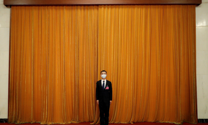 Security member stands guard after the opening session of CPPCC in Beijing