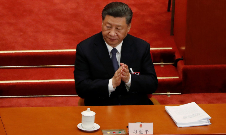 Chinese President Xi Jinping attends the opening session of NPC in Beijing