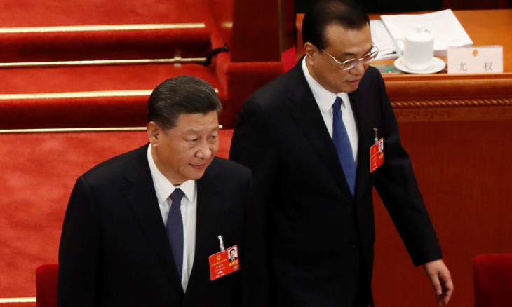 Chinese President Xi Jinping and Premier Li Keqiang arrive at the opening session of NPC in Beijing