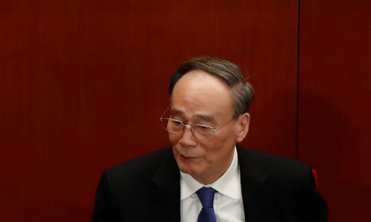 Chinese Vice President Wang Qishan attends the opening session of NPC in Beijing