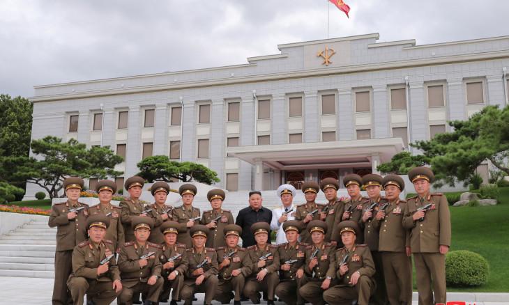"North Korean leader Kim Jong Un poses for a photograph after conferring ""Paektusan"""