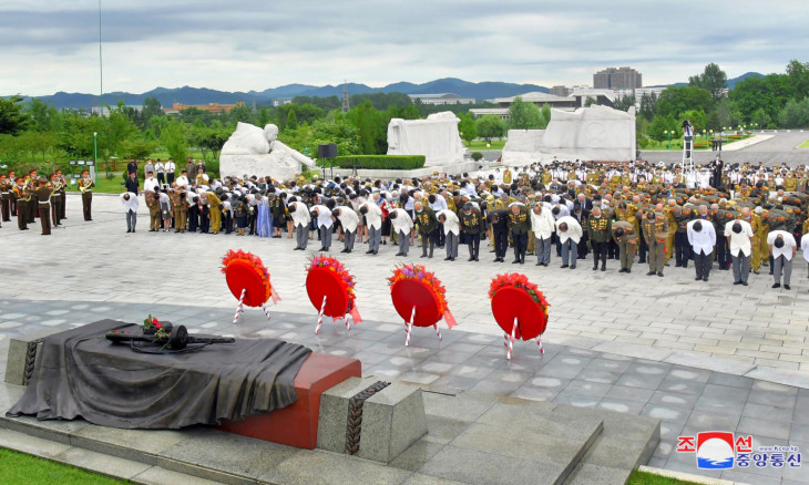 Participants lay wreaths at the War Martyrs Cemetery to mark the 67th anniversary of the Korean War