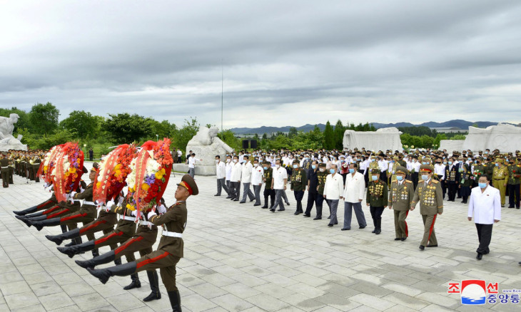 Participants lay wreaths at the War Martyrs Cemetery to mark the 67th anniversary