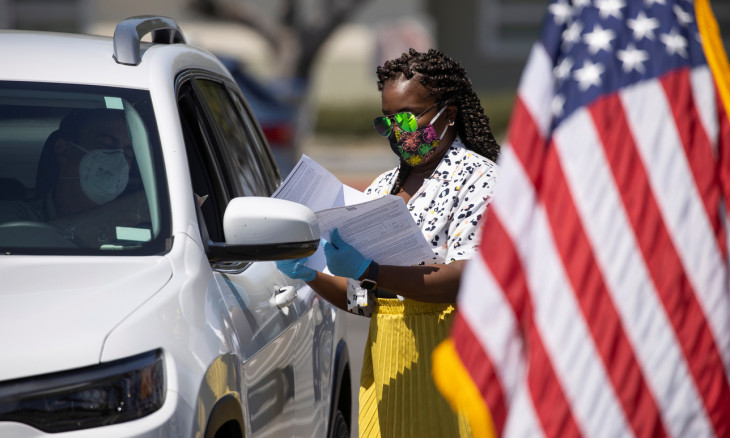A U.S. immigration officer administer helps organize arriving vehicles