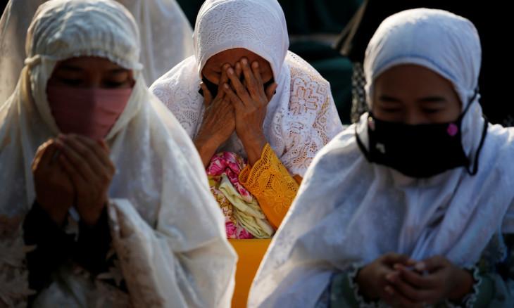Indonesian Muslim women offer Eid al-Adha prayers on the street in Jakarta