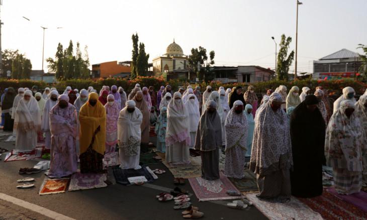 Indonesian Muslims offer Eid al-Adha prayers on the street in Jakarta,