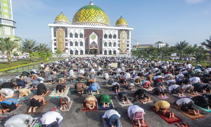 Indonesian Muslims offer Eid al-Adha prayers at Darussalam mosque,