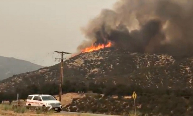 A still image from video obtained from social media of a fire burning vegatation